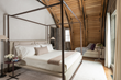 Rush Jenkins of WRJ Design created interiors that would complement the clean lines and rustic materials of the barn's architecture as seen in the bedroom (photo by Audrey Hall).