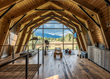 "The barn's ""hayloft"" open workout area's floor-to-ceiling windows capture Teton mountain views along. A contemporary kitchenette by WRJ Design adds sophisticated convenience (photo by Audrey Hall)."