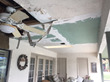 Structural deterioration caused by severe storm damage that led to uninhabitable conditions