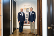 Greg Wozniak and Scott Schmid stand together by Glenview Haus custom doors and in front of a Glenview Haus sign