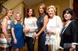Joan Marchi Migliori (far right) with guests