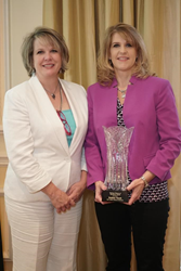 Debbie Vereb receiving Business Woman of Excellence award from NFCC