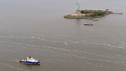 The Neil Armstrong passes the Statue of Liberty during the U.S. Navy's Fleet Week Parade of Ships. The Neil Armstrong is operated by the Woods Hole Oceanographic Institution and owned by the U.S. Navy. It is the nation's most sophisticated oceanographic research platform.  Photo by Peter Massini, Big City Aerials. Copyright Woods Hole Oceanographic Institution