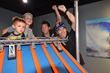 Sebastián Saavedra (Juncos Racing) and Takuma Sato (Andretti Autosport) lead kids to victory on the famous orange track.