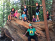Campers explore the redwood forest
