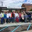 Celebrants gather in front of Velodome's Newport bike shelter in Aurora, IN. to inaugurate the River Cities Bike Share Program.