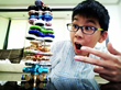 Child stacks dozens of fidget spinners as high as he can before they fall.