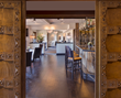 "Massive Old World European carved wooden doors open onto Jimmy's at The Landing, known for its fresh take on Mediterranean cuisine that won the restaurant top honors in the 2017 Best of Tahoe ""Fine Di"