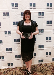 Sherri Dickie, National Recruiting Manager for Vector Marketing Canada, accepts Vector's prestigious Corporate Recognition Award from the Canadian Association of Career Educators and Employers (CACEE)