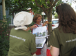 Earthwatch volunteers use a guide to identify trees in Cambridge. Credit: Gitte Venicx