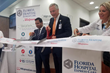 Tampa Ribbon Cutting with Junaid Chowdhury, Regional Healthcare Director, Walgreens, Joe Johnson, President & CEO, Florida Hospital Carrollwood and Jessica Mathews, ARNP