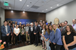 Current and former SLCC students, who have benefited from Miller's generosity to SLCC, gather for a picture with her and Utah Gov. Gary Herbert.