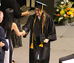 Female graduate receives diploma