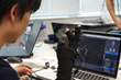 A participant works on his application during the All Japan VR Hackathon in 2016.