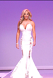 "Gonzalez wore a custom gown by Michael Costello, fashion designer and former contestant on ""Project Runway."" The gown detailed with lace, trimmed with white sequins and flowed as she graced the stage"