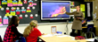 Teacher explains a volcano to student