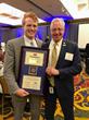 Rep. Joe P. Kennedy III, D-Mass, accepts the award designating him an AbilityOne Congressional Champion from SourceAmerica CEO Steve Soroka.