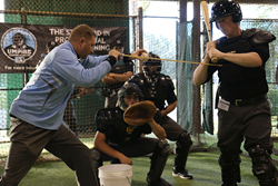 Academy Instructors teaching how to work behind home plate