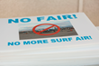 Surf Air Protest organizers ready signs at San Carlos Airport (KSQL) in the San Francisco Bay Area