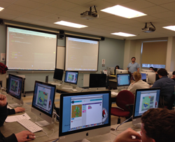 Husson University students learning about computer programming.