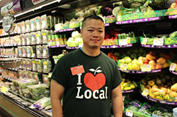 A ShopRite associate stands in the produce aisle