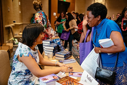 Fans meeting their favorite romance authors at the last Romance Writers of America event.
