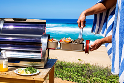 GoSun Grill Solar Cooker Roasting Meat and Veggies on the Beach