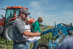Farmers participate in a June field day at the farm of Soil Health Partnership's Roger Zylstra in Lynnville, Iowa.
