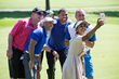 Jalen Rose poses for selfie picture with Seema Sadekar and Golf Participants