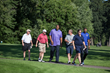Jalen Rose walks the fairway with participants at The 2016 Jalen Rose Golf Classic