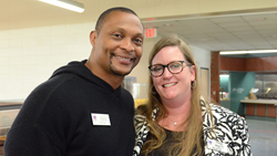 Paige Lester Pruett (at right) with fellow Trustee, Eddie George, following this past May's Board of Trustees meeting