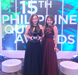 Carla Basa-Martinez and Misha Balajadia accepted the Quill Award on behalf of Qualfon Dumaguete