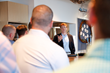 Congressman Kennedy II chatting with Cybereason's employees during his visit.