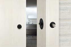 The Privacy Barn Door Lock is a patent-pending, sophisticated yet discreet integrated locking solution. Shown in Graphite Black.