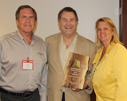 Tom Eggert, Executive Director of the WI Sustainability Council (middle), presenting the 2017 Sustainable Product of the Year Award to John Pade and Rebecca Nelson,  co-founders of Nelson and Pade, Inc.