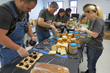 Citrin Cooperman volunteers demonstrate teamwork efficiently assembling hundreds of PB & J sandwiches for distribution to Eva's Community Kitchen guests