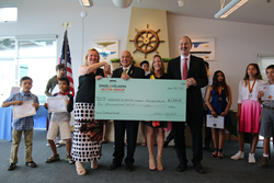 Engel & Völkers VEYTIA GROUP Laguna Beach awards $2000 check to GERMAN SCHOOL campus Newport Beach CA