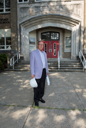 Antinozzi Associates Partner George Perham stands infront of Stratford High Scool, the site of a $125 million renovation