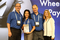 Accepting the Award, from Office Products International Director, Janet Bell, are MMF team members , left to right, Jeff Alm, National Sales Manager, Ivelisse Gomez, Sr Product Development and Marketing Manager, Philip Robins, VP MMF Industries