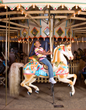 A girl and her horse on the 100-year-old carousel