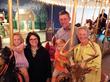 Family photos on a century old carousel