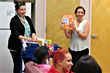 Facilitators from Passaic County Community College demonstrate ways that mothers who live at Eva's Village can use library cart materials to support learning and bonding with their children.
