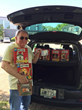 As a Radiant Act of Kindness, Stan Slonka, Executive Director of Blenheim-Newport, delivers treats for cats and dogs at The Potter League animal shelter in Newport, R.I.