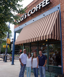Picture of Kevin and Heather Willard standing outside of the original Ziggi's Coffee in Longmont, Colorado with owners Brandon and Camrin Knudsen.