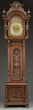 Carved Oak Tall Case Clock with Marked Tiffany & Co. Dial, estimated at $6,000-8,000.