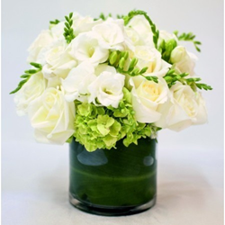 A luxury flower arrangement by Gabriela Wakeham Floral Design called Extra Lush Roses, Freesia, Hydrangea with Green Leaf Wrap. Flower delivery nyc, florist upper east side, florist Chelsea NYC.