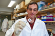 Biomedical engineering professor George Pins, PhD, at Worcester Polytechnic Institute with a patch of woven of biopolymer microthreads that may help repair cardiac muscle damaged by a heart attack.