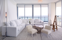 An airy and ethereal living room at the Ritz Carlton Residences Bal Harbour, overlooks Miami Beach.