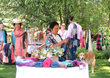 WRJ Design hosted a garden party trunk show in Jackson Hole, Wyoming, to benefit social businesses Ock Pop Tok and Passa Paa with a mission of helping Laos village economies and women weavers.