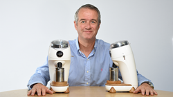 Martin Nicholson designer and CEO of Niche Coffee holds two Niche Zero grinders, designed to be the best coffee grinder.